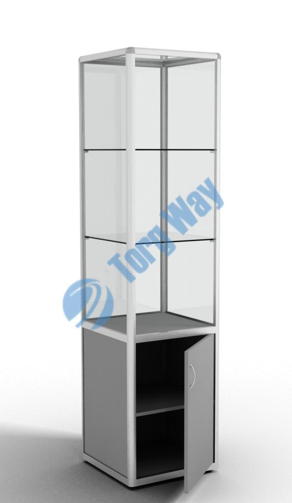 500 X 500 X 2100 алюминиевый профиль системы «Еврошоп». ЛДСП 16 мм серого цвета накопитель 700 мм дверка в накопителе распашная ЛДСП 16 мм 1 полка в накопителе из ЛДСП 16 мм 3 полки из стекла толщиной 5 мм задняя стенка стекло 4 мм торцы стекол обработаны по периметру «Еврошлифовка» уплотнение стекол по периметру