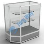 900 X 500 X 900 алюминиевый профиль системы «Еврошоп». ЛДСП 16 мм серого цвета цоколь 200 мм верхняя часть закрыта стеклом 4 мм высотой 700 мм 2 полки из стекла толщиной 5 мм